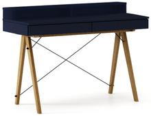 Biurko BASIC+ kolor NAVY stelaż DĄB  Minimalistyczne biurko z dwoma dyskretnymi szufladami. Wykonane ręcznie z litego drewna i blatu w dowolnym odcieniu,...
