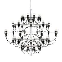 Nowoczesny żyrandol przypominający klasyczny świecznik.  Dwukolorowa konstrukcja pozwoli osiągnąć ciekawe a zarazem niebanalne aranżacje.  Lampa...