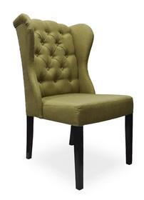 """Krzesło Jack to model z serii chesterfield. Krzesło posiada ozdobne """"uszy"""", które wychodzą z boków oparcia. To właśnie one nadają mu..."""